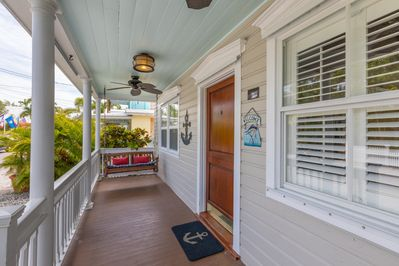 The home's private, covered porch with swing seating for two