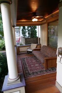 The front porch provides an intimate setting to enjoy a book or the opportunity