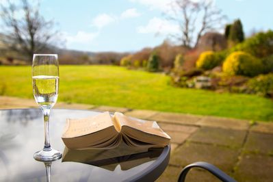 Relax on the original station platform patio and look over to the Lune Valley