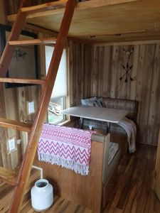 Dining nook, makes into twin bed.