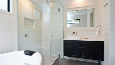 Large shower with rain head, and deep double spa in your ensuite.