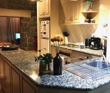 The kitchen opens to the dining and lounge on the ground floor.
