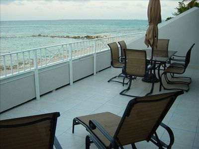 Photo for Oceanfront, 3BR Condo with Huge Patio on Seven Mile Beach