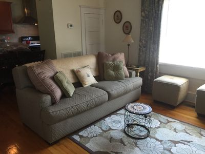 Living room furniture features a lovely green sofa by Rowe.