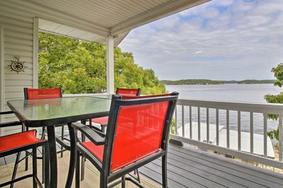 The furnished deck looks out on the Lake of the Ozarks.