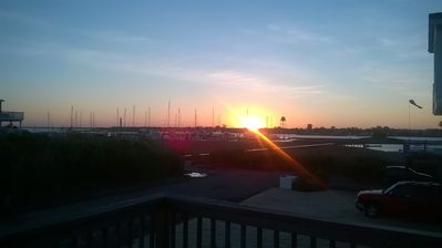 watch sunrise over water from front deck