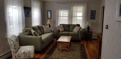 Cozy living room with cable tv and refinished hardwood floor