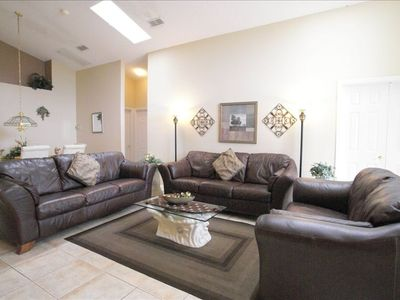 Large living area with new tile floor, high vaulted ceilings
