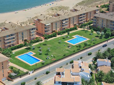 Photo for Apartment with garden & pool - First line Pals beach (GM 3H 424)
