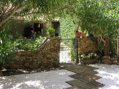 Photo for House full of character with garden and terraces, Grimaud Village