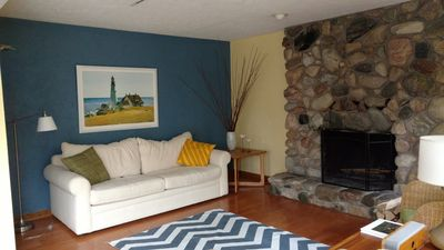 Family room with wood burning fireplace.  Great space for family to gather.