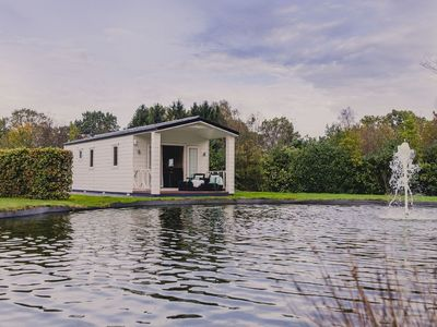 Photo for Cozy chalet on a pond, at the edge of the forest