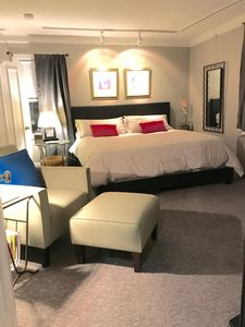 Very spacious bedroom with king bed, Smart TV and lounge chair