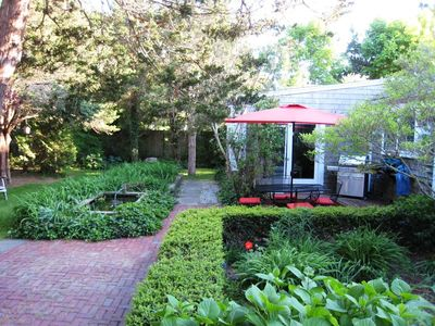 Perennial gardens and fish pond in the very private back yard of this 3 bedroom home!