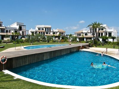 Photo for Holiday home in front of the pool 400 meter from the beach with air conditioning
