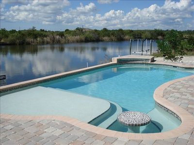Heated Pool built Oct. 2007. Waterfall, lounging area,table top, screened in