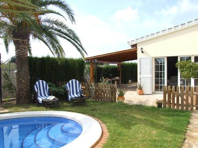 Photo for Oliva house with swimming pool surrounded by orange trees, 500 m wide beach with dunes.