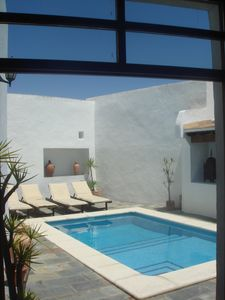 View of the private courtyard and swimming pool from the back door