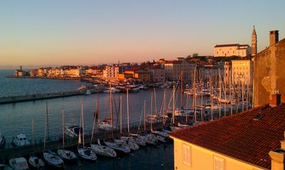 Sunrise over Piran view from terrace