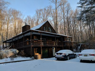 Photo for Secluded Cabin @Poconos with hot tub, game room and grill, sleeps 18