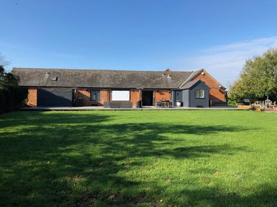 Photo for Large Converted Barn with hot tub, decking, patio, garden - sleeps 8