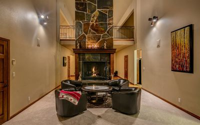 Back of Great room has cozy sitting area with wood-burning fireplace.