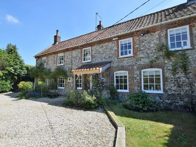 A traditional brick and flint cottage in a pretty Norfolk village