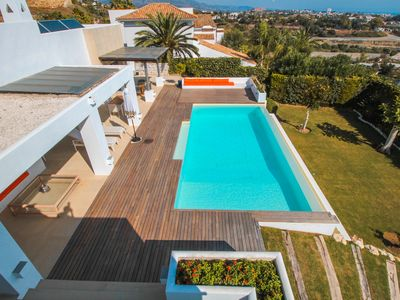 Photo for Stunning immaculate villa available for holiday rentals, infinity pool & views