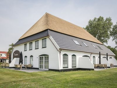 Photo for Apartment in tasteful farmhouse in De Cocksdorp, on the Wadden island of Texel