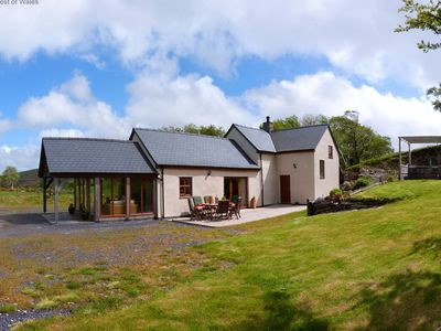 Photo for Drive up a single-track road to a tastefully renovated Denbigh farmhouse with spacious accommodation