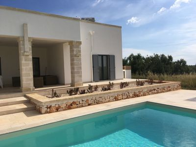 Photo for Stunning Three cone Trullo and Contemporary Villa with private saltwater  pool
