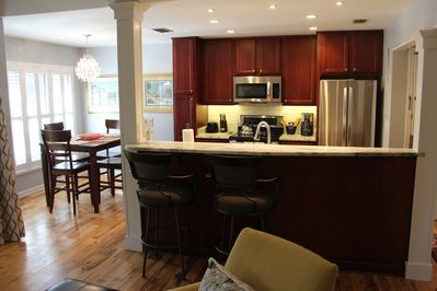 New open concept kitchen with chandelier, and appliances makes this space cozy!