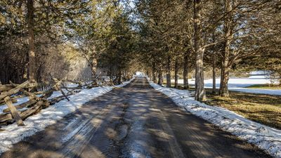 A tree-lined private driveway greets you as you transition to County life.