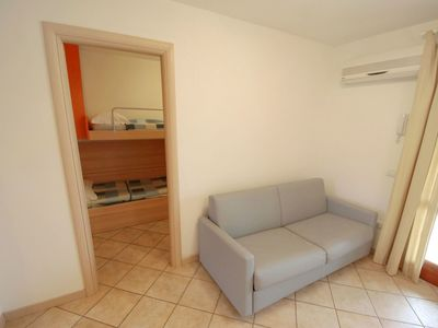 Photo for Lovely apartment for 6 people with A/C, hot tub, pool, TV and balcony