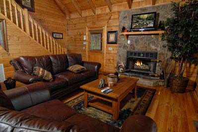 living room with satellite tv and gas fireplace