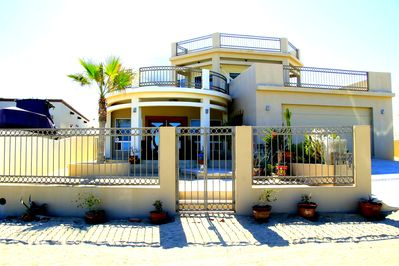 Mediterranean style three bedroom home with fenced front yard with private pool.