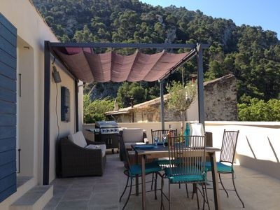 Photo for A large terrace in the sky overhangs the roofs of the village and the Luberon