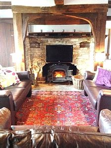 Comfy leather sofas to relax around fireplace/tv
