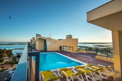 Roof-top pool with sea view