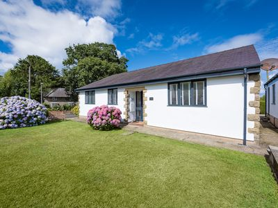 Photo for Positioned in a great location just a short drive to the family friendly beaches of Porthdinllaen, T