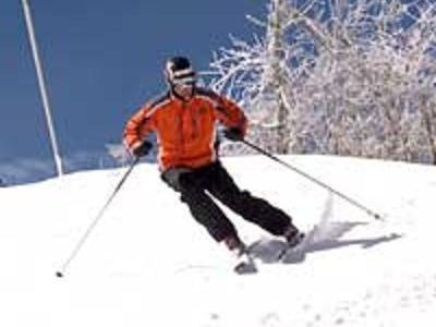 SKIER ON SUGAR MOUNTAIN