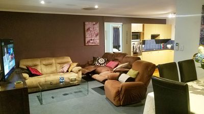 two 3 seater super comfy sofas and a single sofa, with two recliners in one sofa