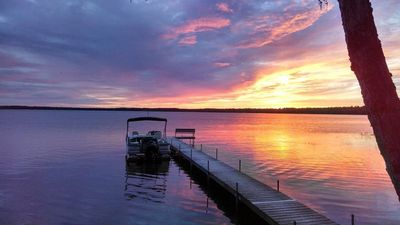 Photo for Best sunsets on the lake! 4 bedroom 3 bath Sunset Getaway, Big St. Germain Lake