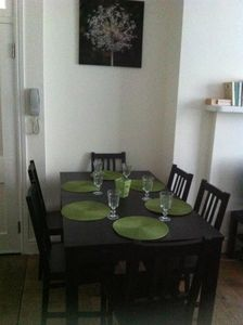 The dining table is to the side of the sitting room and will seat eight people.