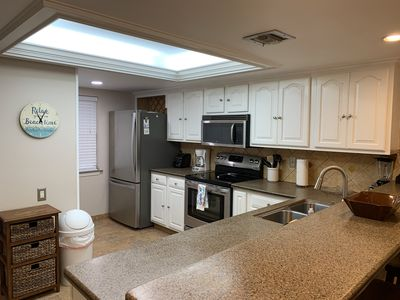 Full Stocked Kitchen with Stainless Steel Appliances, granite like counter-top!