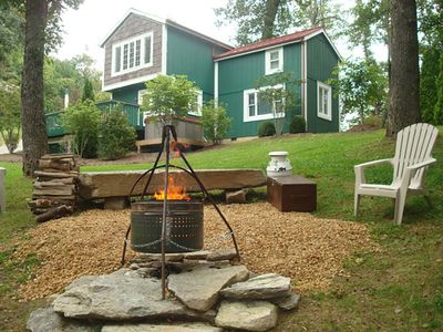 Outdoor fire pit with provided firewood