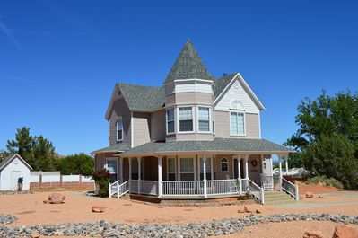 4 bed, 4 bath home in a peaceful neighborhood surrounded by red rock cliffs.