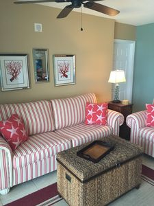 New furniture and decor with starfish and coral for a coastal look.