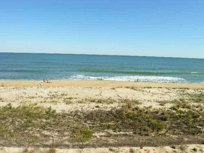 Photo for Lush, stylish 2 bedroom oceanfront condo with free WiFi, beach decor, and a stunning ocean view located uptown and only a few steps to the beach!
