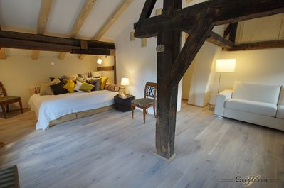 Living/Bedroom on the first floor with historic beams